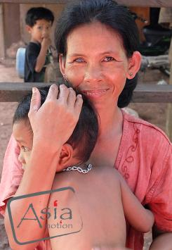 Photo story Asia Motion - lady Niang Pow with one of our child living next gold mine with family.jpg